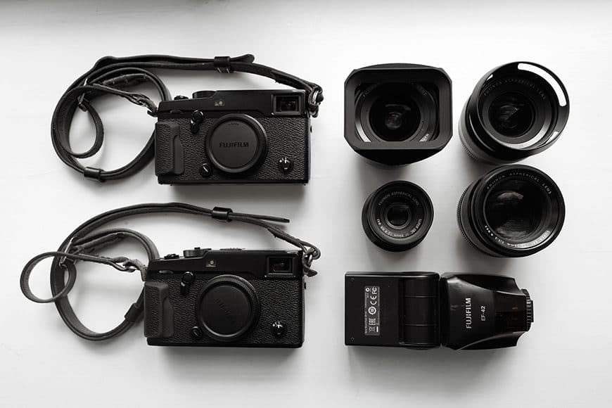 The sexy and simple Fuji mirrorless camera gear of Nordica featuring two Fuji X-Pro2 bodies.