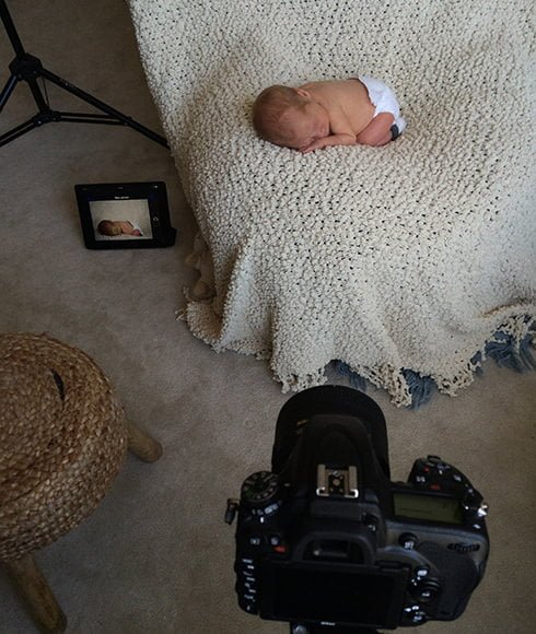 iPhone pic showing Behind the Scenes at a newborn shoot, using Nikon D750 built-in Wifi