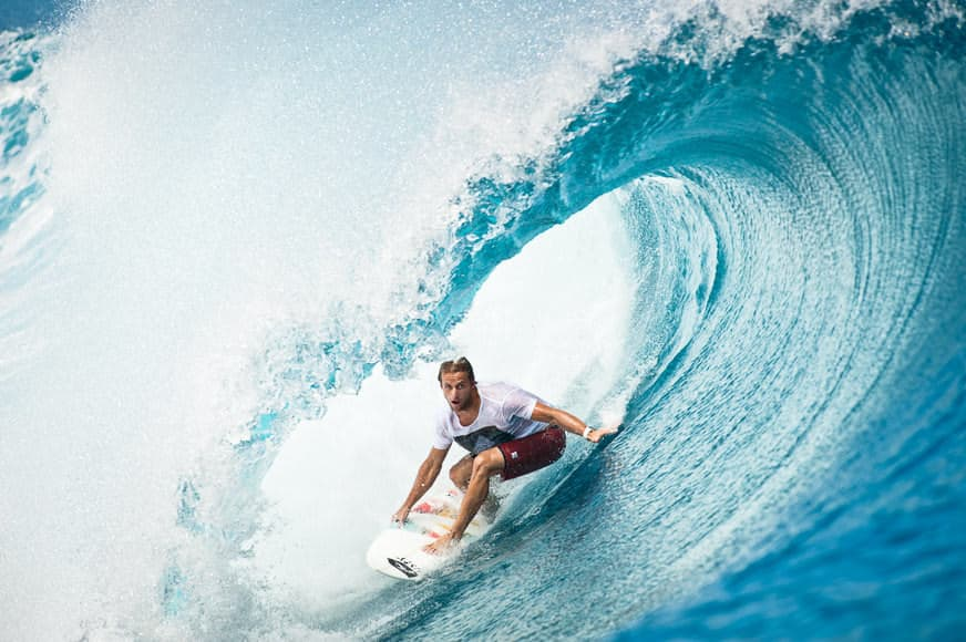 Pro surfer Dylan Longbottom surfing a sizable wave at Teahupo'o, Tahiti.