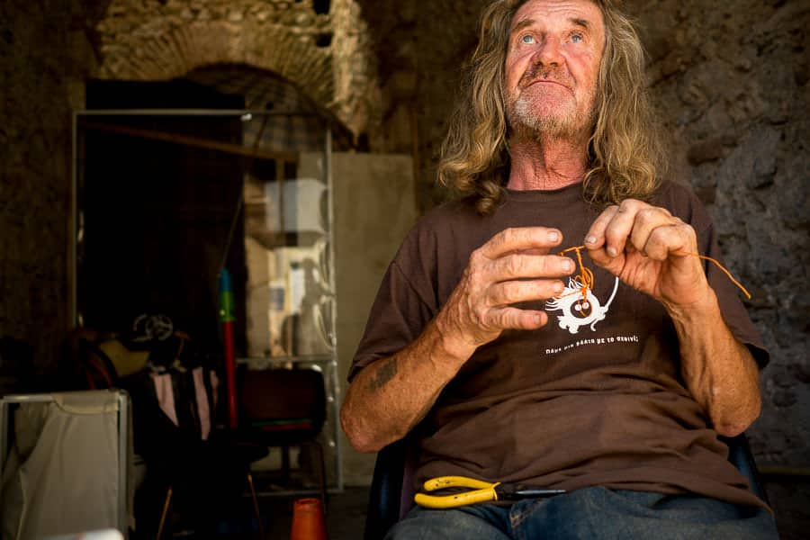 This is Tom who makes his living on a street corner in Athens, selling bicycles made out of wire for 1 Euro!