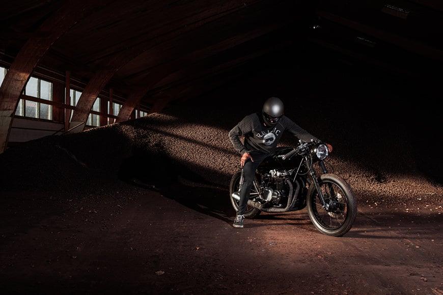 Portrait of a biker on a motorbike taken with the Fujifilm X100F