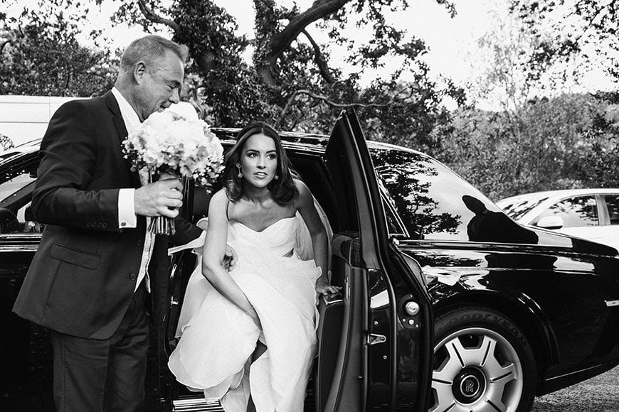 Bride exiting bridal car shot with a Leica Q mirrorless camera