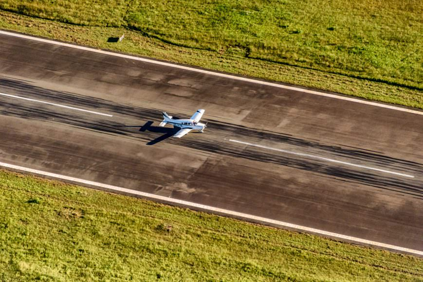 Small plane landing at second runway of Salvador Airport, Brazil