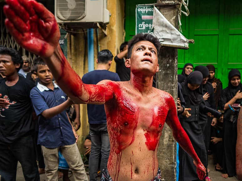 24 OCTOBER 2015 - YANGON, MYANMAR: Shia men and teenagers participate in ritual self flagellation with razors and chains during Ashura observances at Mogul Mosque in Yangon. Ashura commemorates the death of Hussein ibn Ali, the grandson of the Prophet Muhammed, in the 7th century. Hussein ibn Ali is considered by Shia Muslims to be the third imam and the rightful successor of Muhammed.    PHOTO BY JACK KURTZ