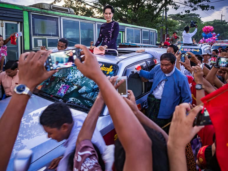 01 NOVEMBER 2015 - YANGON, MYANMAR:  AUNG SAN SUU KYI, the head of the NLD, drives through a crowd of supporters as she leaves the NLD's last election rally of the 2015 election in the Yangon suburbs Sunday. Political parties are wrapping up their campaigns in Myanmar (Burma). Suu's party won the Myanmar elections in November 2015.  PHOTO BY JACK KURTZ