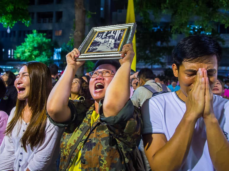 13 OCTOBER 2016 - BANGKOK, THAILAND:  People at Siriraj Hospital cry and comfort each other Thursday evening after the death of their revered King, Bhumibol Adulyadej was announced.      PHOTO BY JACK KURTZ