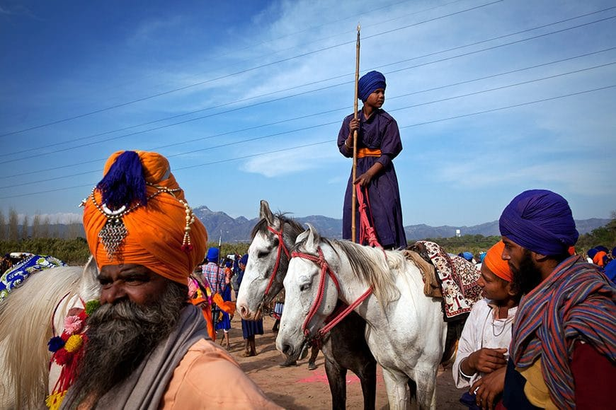 Hola Mohalla is an annual Sikh festival that takes place around the time of the Hindu festival of Holi. It marks the establishment of the Khalsa Panth - the martial wing of the Sikh people, by Guru Gobind Singh, the 10th Guru in 1699. It takes place in Anandpur Sahib, around the Gurudwara where he formed the Khalsa, called Keshgarh Sahib. The various 'Dals' or 'Deras' take part in a procession through the town to the stadium, where the Nihangs ride their horses, and exhibit 'Gatka'. There are immense crowds that have to keep running away from the galloping horses.