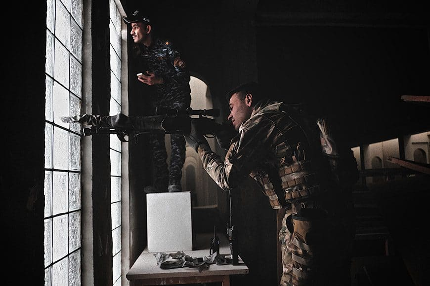 Rapid Response snipers of the Iraqi Federal Police take aim from the Mosul Museum building at ISIS snipers hindering them from pushing deeper into the city center on March 11, 2017. (Photo by Osie Greenway)