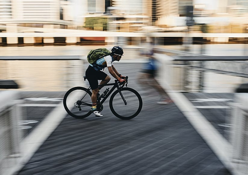 the right shutter speed can give motion blur - variable focal length zoom lens used to shoot cyclist.