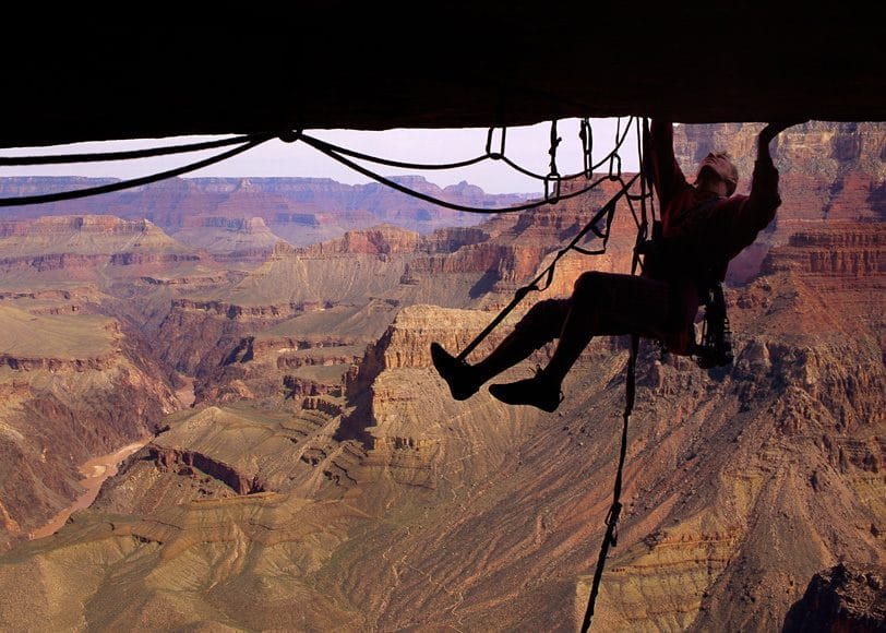 The Grand Canyon is my backyard that has unlimited potential for exploration. I have spent hundreds of days exploring below the rim, have enjoyed many river trips through the gorge and climbed dozens of towers in the canyon. In this photo an aid climber peaks his head around the lip of a massive roof.   ©Bill Hatcher
