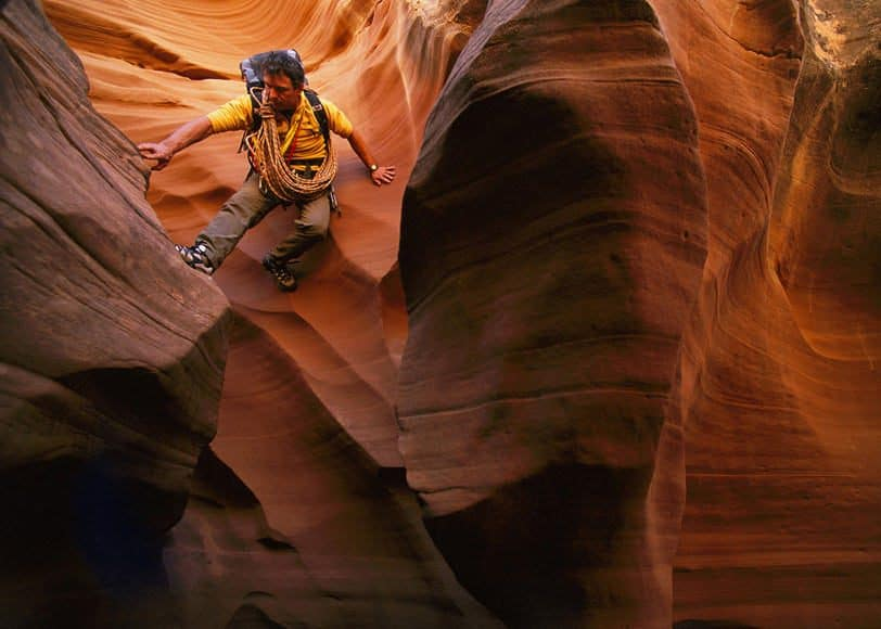 Australian climber and mountaineer Greg Child exploring the surreal canyon scape in the slots of Waterholes Canyon, Arizona.