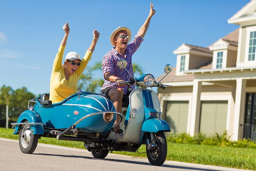 Cruising an antique Vespa was just in the day's work for two models in a resort advertising campaign for a community in Naples, Florida. Photo by Steven Martine Photography Inc.