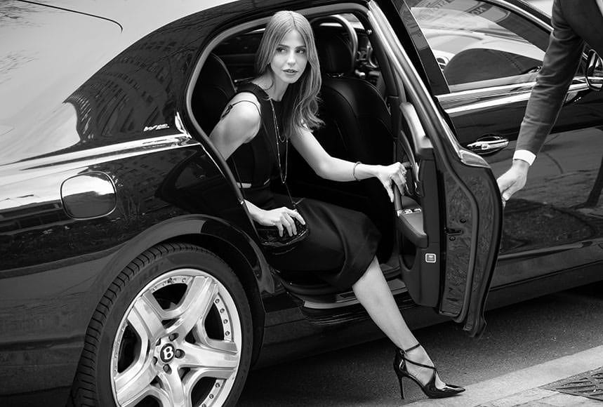 Model exits a Bentley motorcar while on an advertising campaign photo shoot in Philadelphia for a private developer of luxury lifestyle communities.