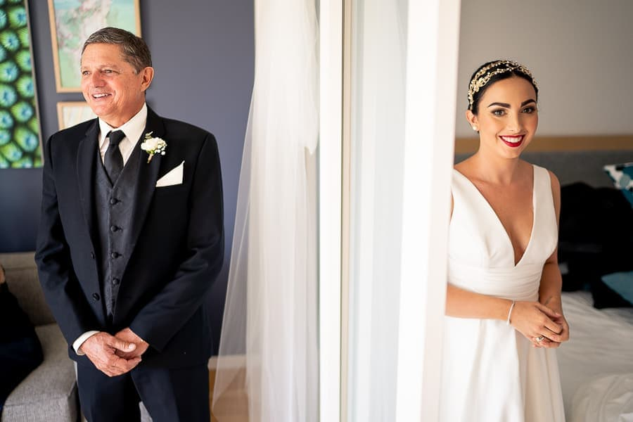 brides father sees bride in dress