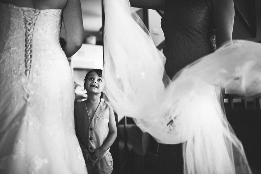 child seeing bride