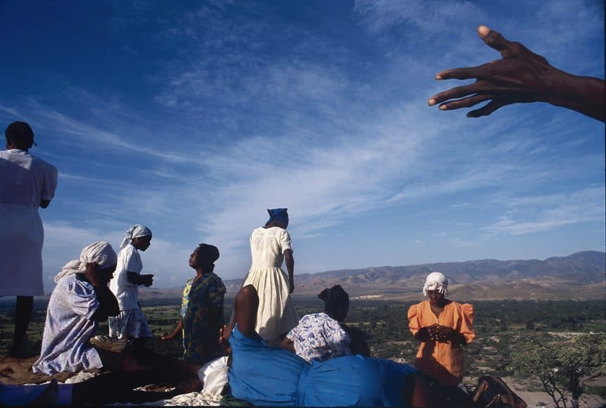 RELIGIOUS PILGRIMS PRAY IN THE MORNING SUN ATOP A HILLSIDE OUTSIDE GONAIVES, HAITI IN December 1994.  THEY CLIMB TO THE TOP EVERY MORNING TO PRAY FOR FOOD, MONEY, HEALTH, SALVATION.