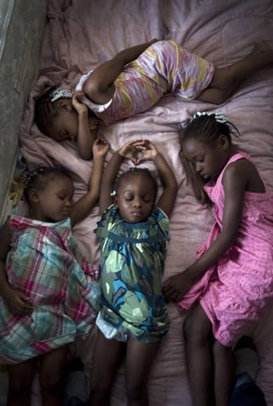 PHOTOS BY MAGGIE STEBER Mia Dennis' daughters, ages 3 to 8,  take their nap on Sunday afternoon.  Girls are:  Frederika Wright, 8 (pink dress), Alexis Johnson, 5 (pink/yellow dress), Connie Johnson, 4 (plaid dress) and Amelia Johnson, 3, in middle of photo.  CONTACT:  Mother Mia Dennis: 305-896-6317 or 8317; also grandmother Mary Trody at 786-413-6039 or through photographer Maggie Steber if you have problems contacting them:  305-757-6167