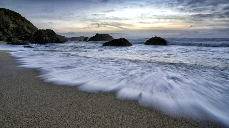Long exposure wave - sunset photos - learn basics of photography first then apply to setting sun for amazing results