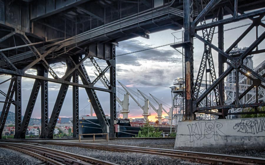 Sunset under Burnside Bridge, Portland, Oregon - sun in distance