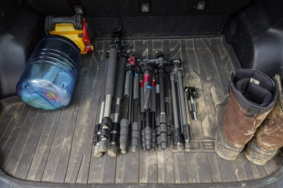 my collection of camera tripods laid out in truck