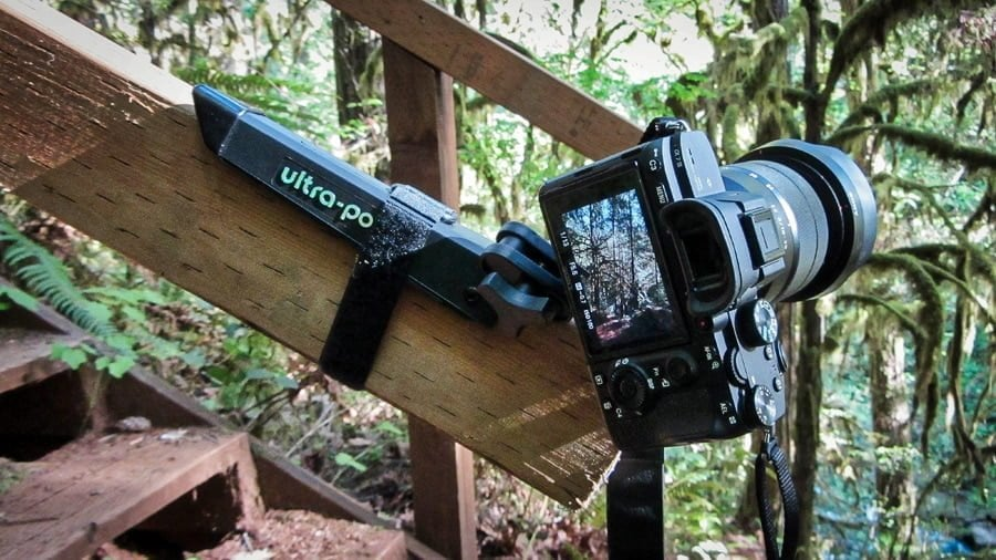 The Ultrapod 2 attached to a wooden railing - traveler tripod
