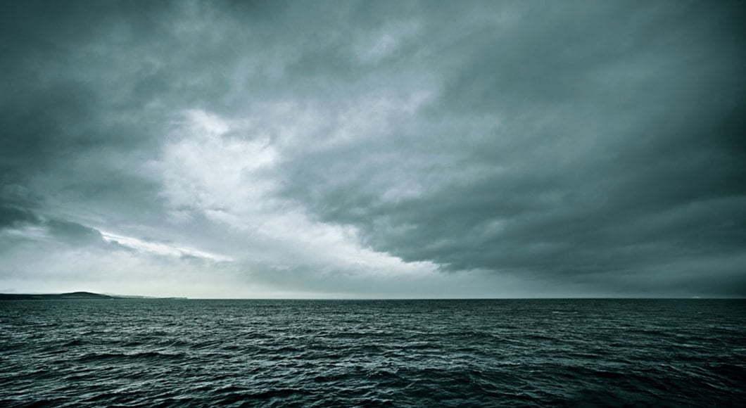 Grey clouds over ocean