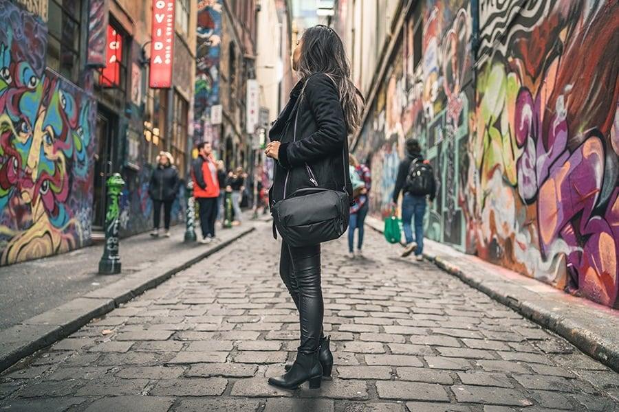 Peak Design Everyday Sling on lady with grafitti walls