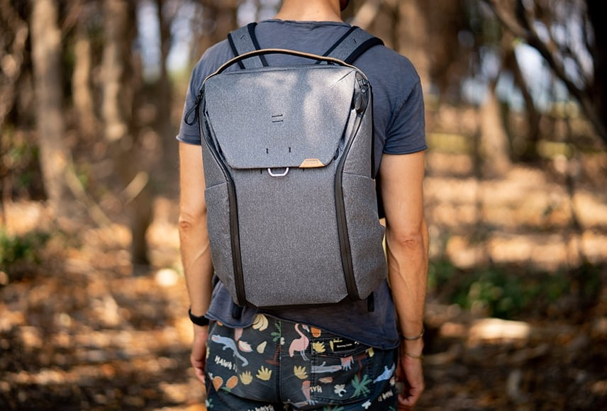 man wearing best peak design everyday camera backpack in woods