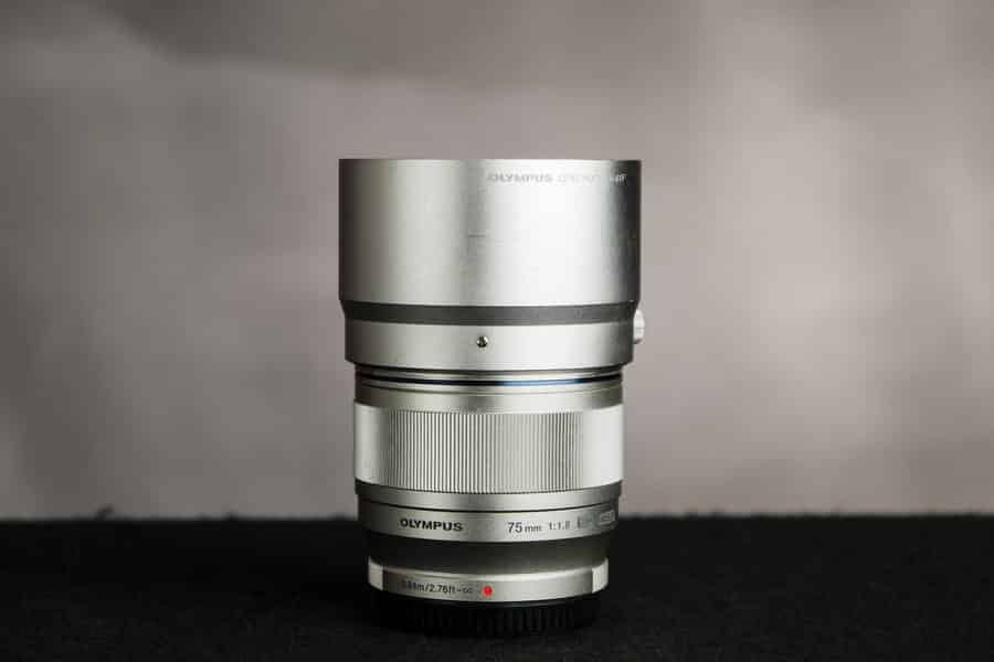 A close up look at the silver version of the Olympus 75mm f/1.8 lens.