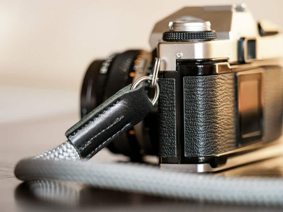 Close up photo of Rock and Roll Snake Rope Camera Strap leather endings.