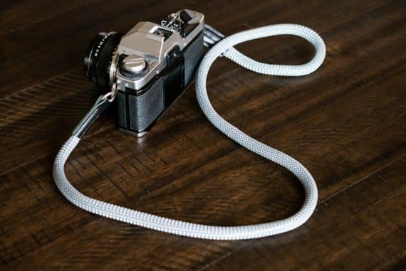 Rock and Roll rope strap attached to a 1970's Olympus OM-G film camera.