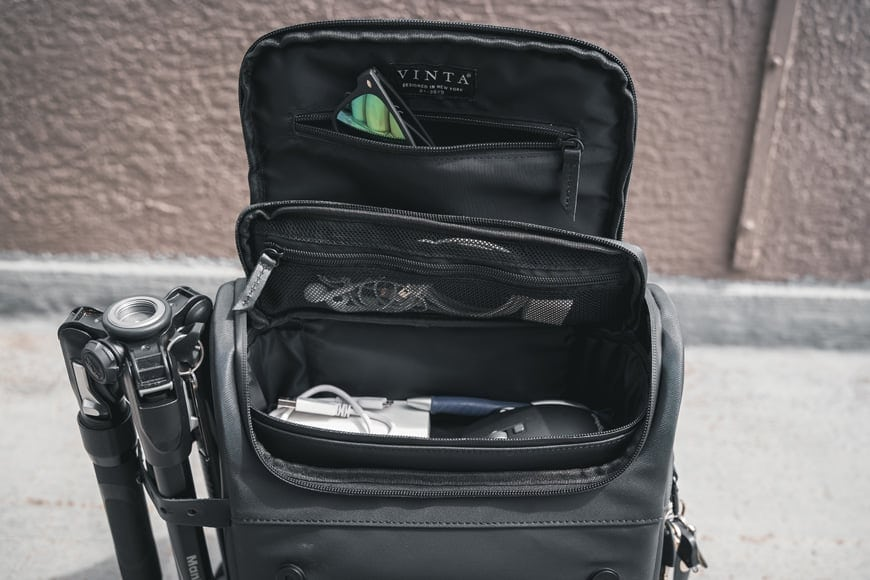 Underneath the Vinta Type-II Backpack's top lid is a zipper layer which gives you access to the Compact Field Pack inside.