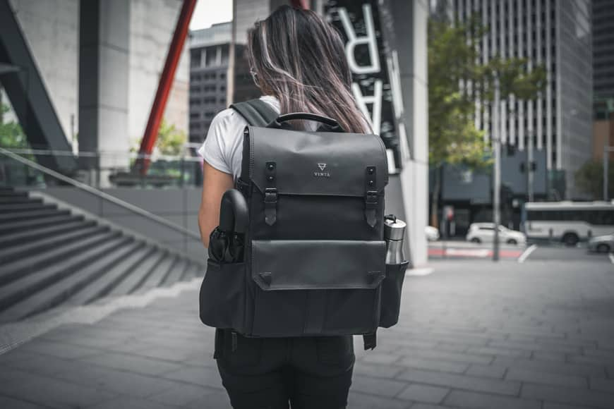 The Vinta Type-II Backpack features dual side pockets which can be closed up by a zipper when not in use.