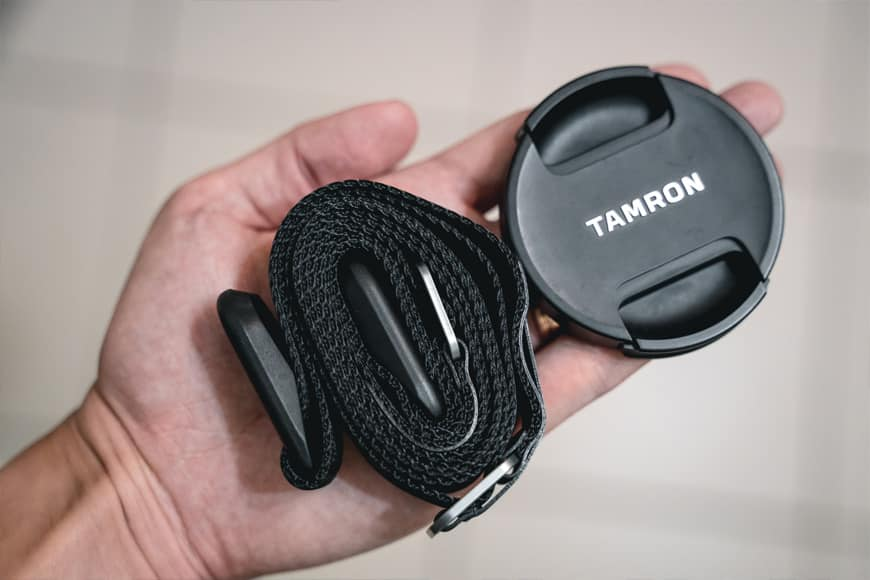 When rolled up the Peak Design Leash will easily fit in to a small pocket in a bag, here it's next to a 67mm lens cap.