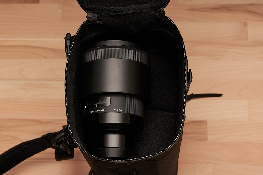 you can fit a good size prime lens in the camera pack of black ember wprt