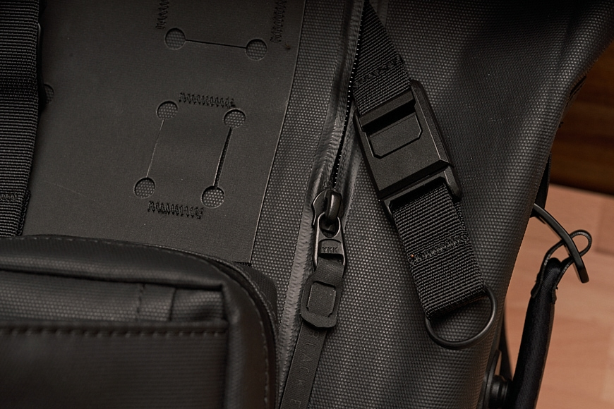 detail shot of the Black Ember WPRT roll-top camera backpack