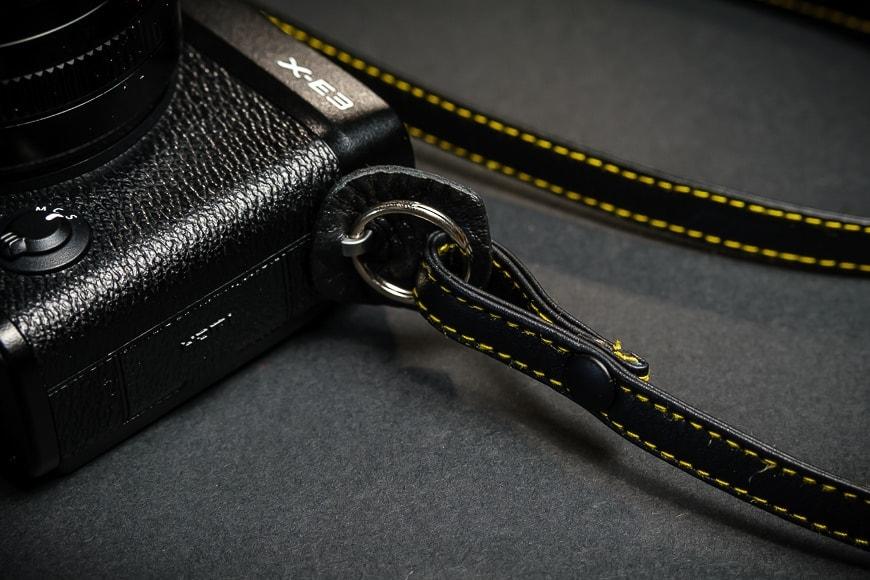 The Cecilia Thin Camera Strap has incredibly strong attachment hardware.