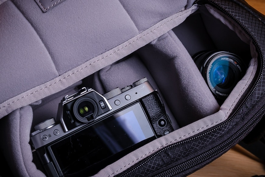 Thanks to the wide access pocket on the Pacsafe Camsafe X9 Sling, you can access much more than your camera.