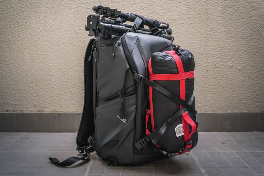 If you use the waist straps along with the other cargo straps you can carry multiple things on the outside of the PGYTECH OneMo Backpack.