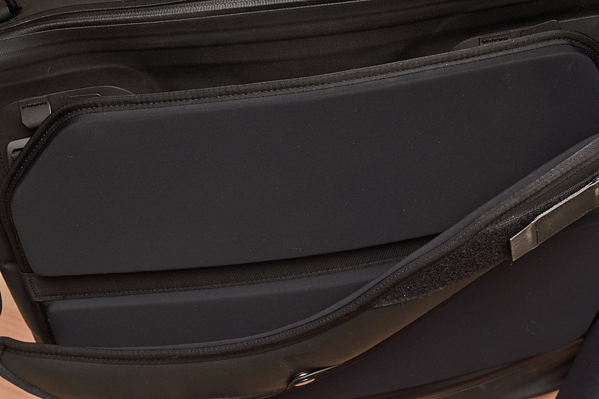 The padding is separate from the bag, which is unusual but works well. This also allows for a luggage pass-through.