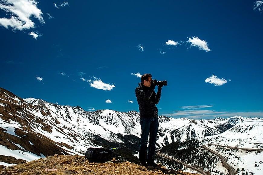 Man taking photos in the mountains