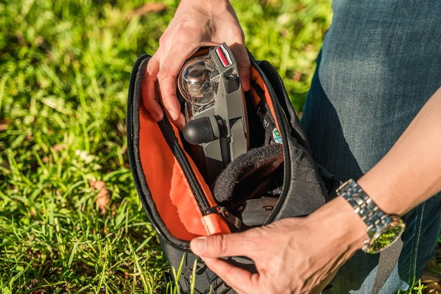 The bright orange interior and the extra thick padded dividers definitely stand the Instinct X-Pac Pro Camera Sling Bag apart!