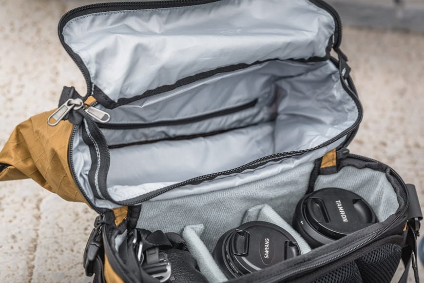 The dual sided zipper provides access between both of the main compartments inside the Sling 11.