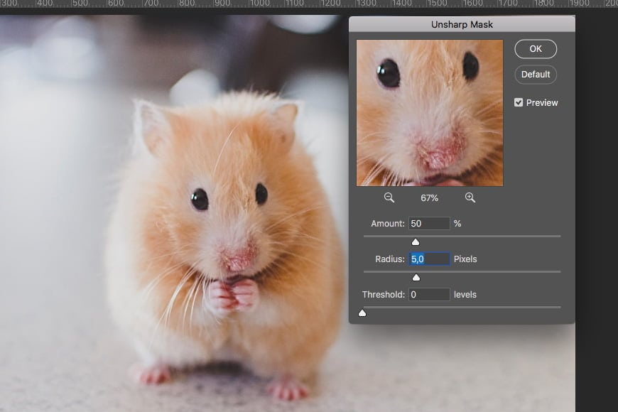 Sharpen an image in photoshop using unsharp mask filter. Adjust the radius, amount and threshold values to fix the sharpen filter.