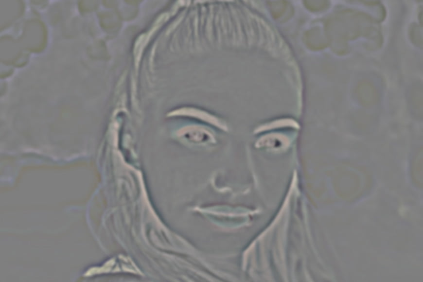 Gaussian blur smoothes skin but we next need to invert the Photoshop layer.