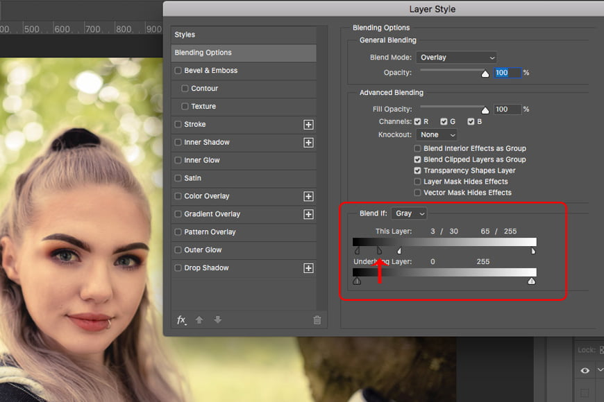 Next step in this photoshop tutorial is to adjust the blending on the blur layer. This smooths skin while retaining more skin texture.