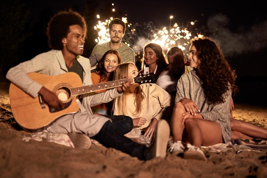People singing on beach.