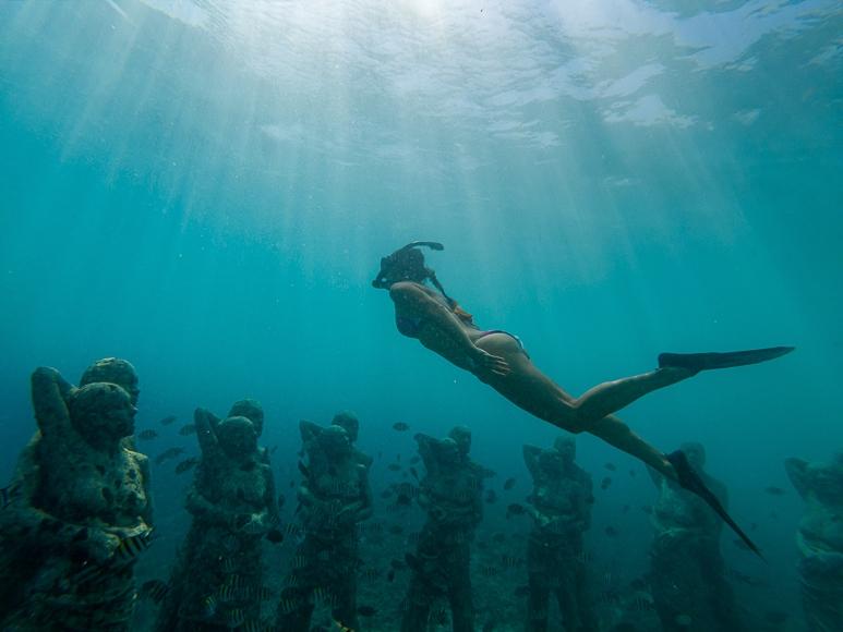 Underwater woman in bikini.