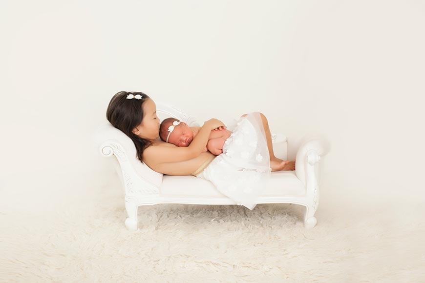 Baby sized furniture is great in photos as newborn photography props.