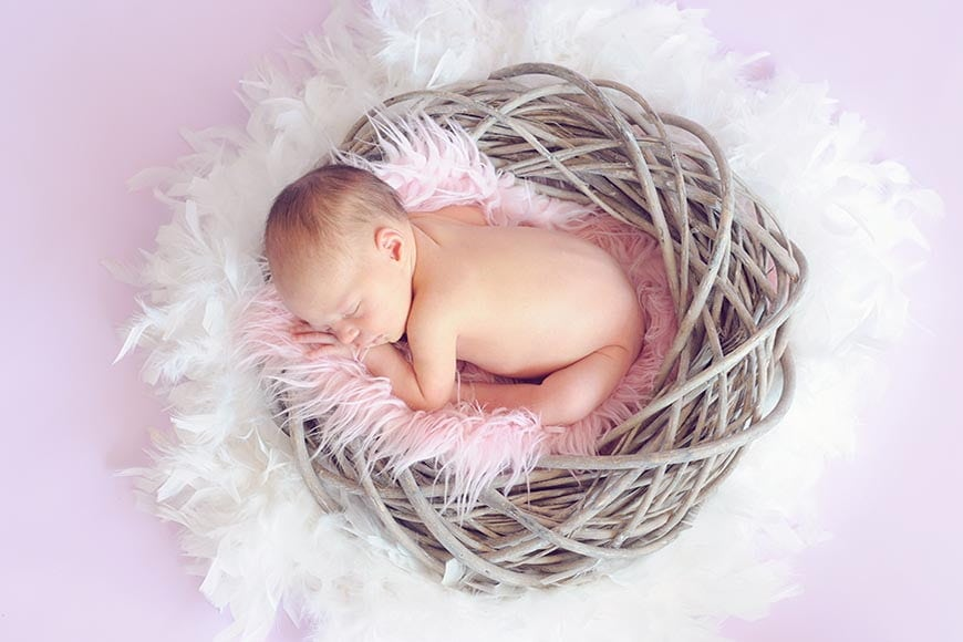 Try a basket or bean bag when looking for newborn photography props.